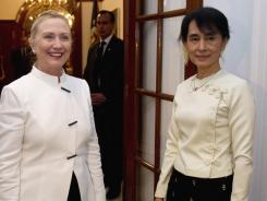 Secretary of State Hillary Rodham Clinton and pro-democracy opposition leader Aung San Suu Kyi talk prior to dinnerThursday in Burma.