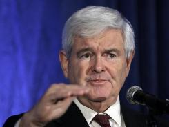Republican presidential hopeful former House Speaker Newt Gingrich speaks at the annual meeting of the Iowa Association of Electric Cooperatives on Thursday in West Des Moines, Iowa.