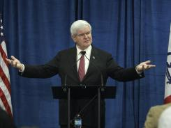 Republican presidential candidate, former House Speaker Newt Gingrich speaks during a meeting with employees at Nationwide Insurance on Thursday in Des Moines, Iowa.