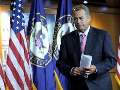 House Speaker John Boehner leaves his news conference on Capitol Hill in Washington on Thursday.