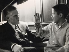 George Romney, left, and son Mitt in their Detroit home in 1957.