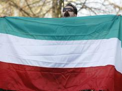 A protester against the Iranian government demonstrates Friday outside the Iranian Embassy in London. Britain ordered Iranian diplomats off its soil.