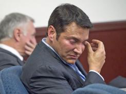 James Arthur Ray wipes during a pre-sentencing hearing in Prescott, Ariz., on Nov. 8. Ray began serving a two-year sentence last month on a trio of negligent homicide convictions.