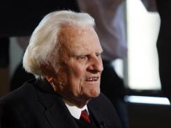 Billy Graham, shown in a photo from last December, had a restful night at a hospital, a spokeswoman said.