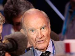 In this Aug. 25, 2008, file photo, former U.S. Sen. George McGovern walks on the floor during the Democratic National Convention in Denver.