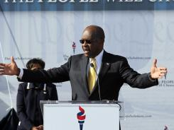Herman Cain addresses supporters in Atlanta on Saturday.