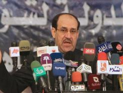 Iraqi Prime Minister Nuri al-Maliki speaks November 26, 2011, at a conference in Baghdad.