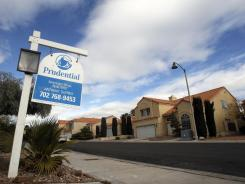 A for-sale sign is shown Friday in The Lakes neighborhood in Las Vegas.