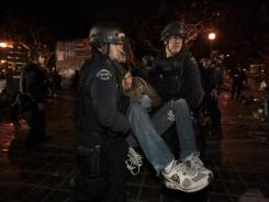 A protester is arrested as Los Angeles police officers dismantle the Occupy LA encampment outside City Hall in Los Angeles on Nov. 30.