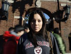 In this Nov. 18 photo, Harvard University student Lanya Olmstead stands in front of an entrance to the school's quad.