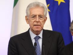 Italian Premier Mario Monti briefs the media Sunday in Rome following a Cabinet meeting to discuss emergency austerity and growth measures aimed at saving the euro currency from collapse.