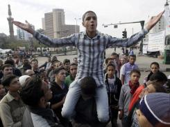 Egyptian protesters rally Sunday in Cairo's Tahrir Square, demanding that the military council ruling Egypt since President Hosni Mubarak's ouster step down.