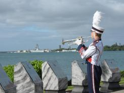 Neil Hillam plays taps at the USS Arizona Memorial in Pearl Harbor for a commemoration in November.