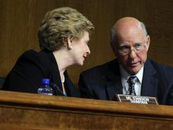 Sen. Debbie Stabenow, D-Mich., confers with Sen. Pat Roberts, R-Kan., during a Senate hearing on Dec. 1.