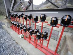A memorial at the entrance to Massey Energy's Upper Big Branch coal mine on April 5 marks the first anniversary of an explosion that killed 29 coal miners.