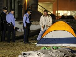 An Occupy New Orleans demonstrator gathers his possessions Tuesday as police clear out the encampment in Duncan Plaza in New Orleans.