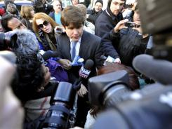 Former Illinois Gov. Rod Blagojevich arrives home Wednesday after receiving a 14-year prison sentence in federal court in Chicago for attempting to sell President Obama's old Senate seat.