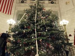 """Holiday tree"" : In Rhode Island, a debate remains over the tree standing in the Capitol."