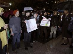 Occupy D.C. demonstrators chant slogans outside of the White House during a protest on Wednesday.