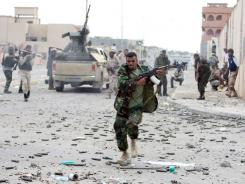 Libyan rebels fought loyalist troops Oct. 19 in Sirte, one of the last bastions of Moammar Gadhafi. Estimates of the Libyan army under Gadhafi's rule ranged from 50,000 to 130,000 troops.
