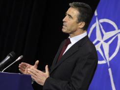 NATO Secretary General Anders Fogh Rasmussen speaks during a media conference Thursday in Brussels. NATO's foreign ministers, in a two-day meeting, will review plans for a missile defense system.
