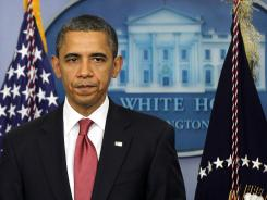 President Obama delivers a statement urging Republicans in Congress to join Democrats to ensure taxes don't go up on middle class families in the Brady Briefing Room of the White House.
