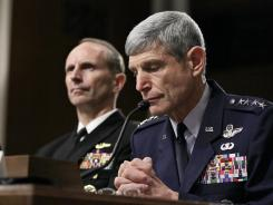 Air Force Chief of Staff Gen. Norton Schwartz responds to reports about Dover's Port Mortuary during a Senate Armed Services Committee hearing on Nov. 11. At left is Chief of Naval Operations Adm. Jonathan Greenert.