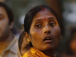 A woman cries on Friday outside a morgue in Kolkata, India. Staff at a hospital fled for safety early Friday as the building burned, officials said.