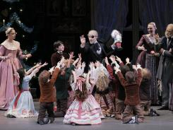 "This publicity image shows Adam Hendrickson as Herr Drosselmeier, center, in New York City Ballet's production of George Balanchine's ""The Nutcracker."""