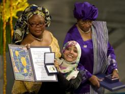 The 2011 Nobel Peace Prize laureates, Liberian President Ellen Johnson Sirleaf, right,liberian peace activist Leymah Gbowee, left and Yemeni activist Tawakkol Karman, center, pose on December 10.