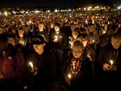 Members of the Virginia Tech community hold a candlelight vigil to honor Virginia Tech police Officer Deriek Crouse on Friday in Blacksburg, Va.