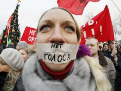 "A protester stands during a rally in downtown St. Petersburg, Russia, on Saturday. The sign reads ""No vote."""