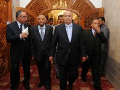 Yemeni Vice President Abdo Rabbo Mansour Hadi, second right, and newly appointed Yemeni Prime Minister Mohammed Basindwa, second left, arrive in the Presidential Palace in Sana'a, Yemen, on Saturday.