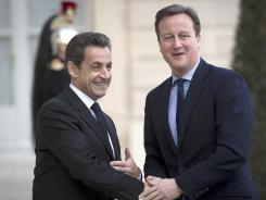 France's President Nicolas Sarkozy, left, welcomes British Prime Minister David Cameron last week.