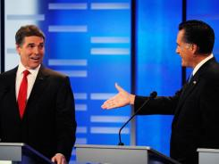 Texas Gov. Rick Perry and former Massachusetts governor Mitt Romney participate in Saturday night's GOP presidential debate in Des Moines.
