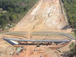 Work continues on a new portion of I-49 near Vivian, La., in September. Overruns with this project include a $2.5 million mistake calculating how much dirt to remove.