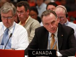 Canadian Minister of Environment Affairs Peter Kent listens during final talks at the Durban climate conference.