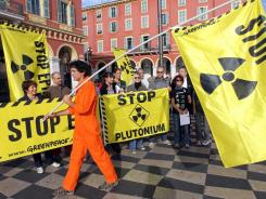 Greenpeace activists in Nice, France,  demand the closure of nuclear power stations in October.