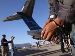 An undocumented immigrant prepares to board a deportation flight to Guatemala City at Phoenix-Mesa Gateway Airport on June 24.