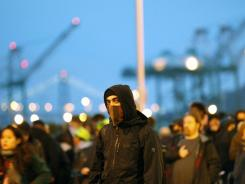 Protesters attempt to block an entrance to the Port of Oakland on Monday.