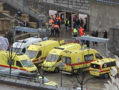 Ambulances and police on the Saint-Lambert square in Liege, Belgium, after a man threw multiple grenades.