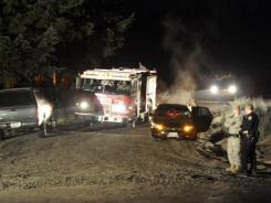 A Fort Lewis fire engine leaves the scene off Rainier Road in Thurston County, Wash., where two Army OH-58 helicopters crashed, killing four soldiers Monday, Dec. 12.