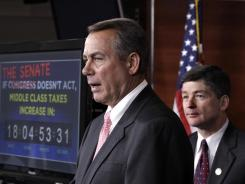 House Speaker John Boehner speaks Tuesday after passage of legislation to extend Social Security payroll tax cuts.