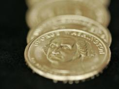 The presidential dollar coin has fallen victim to Washington's cost cutting efforts. The White House said Tuesday it is stopping nearly all production of the coins.