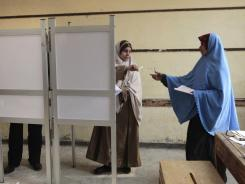 Egyptian women prepare to vote at a polling station in Giza, Egypt, on Wednesday.