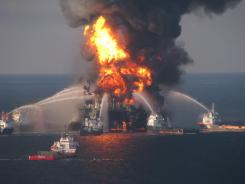 Fire boat response crews spray water on the blazing remnants of the Deepwater Horizon offshore oil rig on April 20, 2010.
