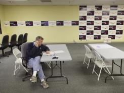 Gingrich volunteer Ben Bishop calls voters Wednesday in Urbandale, Iowa.