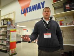 Kmart store manager Ted Straub talks Thursday in his Omaha store. Dozens of Kmart customers across the country have had their layaways paid off by strangers.