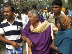 Relatives of victims gather at Diamond Harbour hospital, after dozens died and more than a hundred fell sick drinking bootleg liquor in the village of Sangrampur.