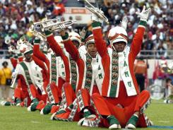 Before bandmate's death:  Florida A&amp;M's Marching 100 perform during the halftime show in Orlando. After Robert Champion died, the band was suspended and several investigations were launched.